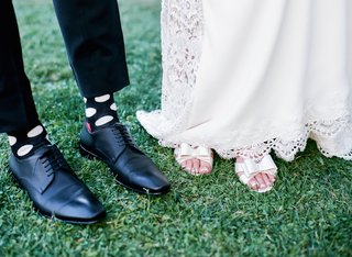 grooms-black-shoes-socks-with-light-polka-dots-brides-kate-spade-shoes-with-bows