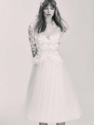 black-and-white-photo-of-elie-saab-bridal-spring-2017-tulle-short-wedding-dress-long-sleeves-flowers