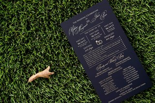 wedding-ceremony-program-card-with-story-of-couple-and-list-of-parents-and-honor-attendants-black
