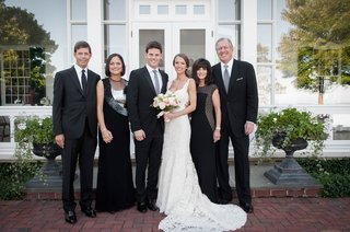 bride-in-ines-di-santo-dress-with-husband-and-parents