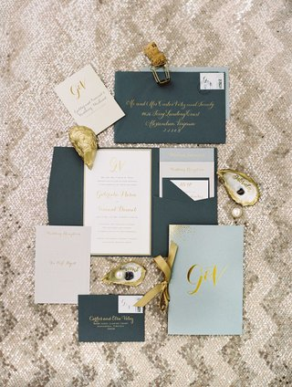 navy-blue-grey-envelope-invitation-with-gold-calligraphy-light-blue-wedding-program-gold-ribbon