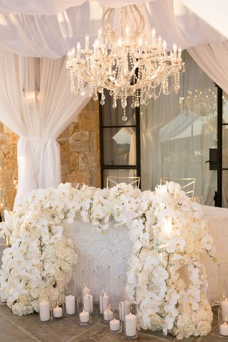 wedding reception sweetheart table malibu rocky oaks vineyard estate chandelier white orchid rose