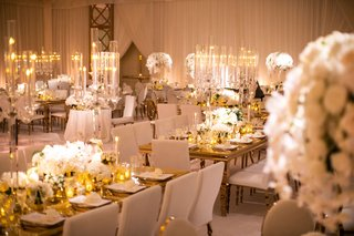 wedding reception white gold decor tall candelabra white flowers the hidden garden geller events
