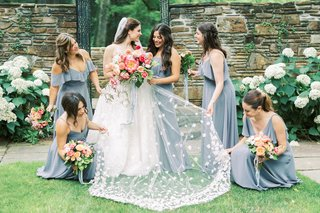 A Charming Fete Bride and Bridesmaids peony bouquets
