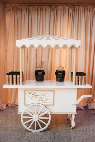 cute-coffee-bar-cart-at-wedding-reception-drapery-coffee-holder-thermos-on-white-cart-tray-wedding