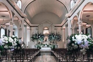 vibiana-indoor-wedding-ceremony-indoor-wedding-with-white-and-green-floral-arrangements