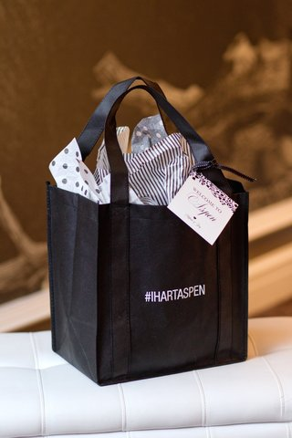 white-and-black-bag-printed-with-wedding-hashtag