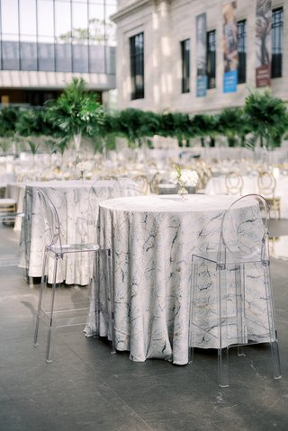 wedding-reception-cleveland-museum-of-art-ghost-bar-stools-at-tables-with-marble-design-linen