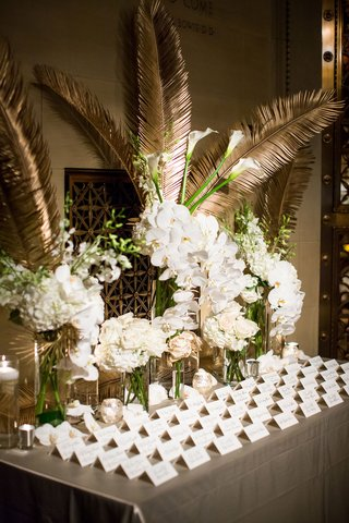 wedding-reception-escort-card-table-white-rose-hydrangea-orchid-gold-palm-leaf-frond-escort-cards