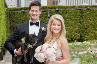 bride-with-pink-peony-bouquet-and-groom-in-bow-tie-holding-french-bull-dog-with-flower-collar