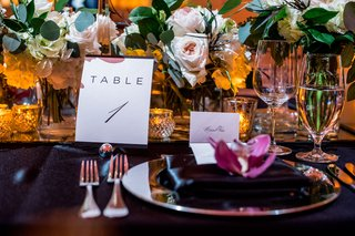 wedding-reception-black-linens-with-pink-and-white-flowers-greenery-burgundy-flower-minimalist