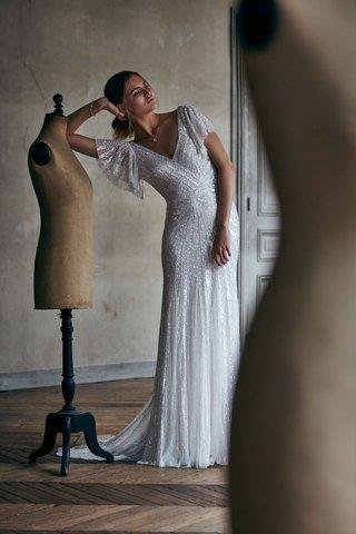 cibella-eliza-jane-howell-bhldn-sparkle-wedding-dress-with-v-neck-beading-and-flutter-sleeves