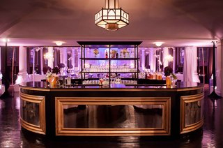 gold-and-black-wedding-bar-with-purple-lighting-at-vibiana-reception