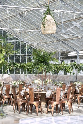 wedding-reception-greenhouse-venue-woven-lantern-pendant-pedestal-table-industrial-copper-chairs
