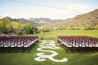 silverleaf-club-wedding-ceremony-with-white-flower-petal-aisle-and-mountains-in-background