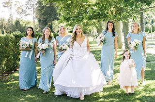 bridesmaids-in-robins-egg-blue-holding-bouquets-with-bride-holding-up-dress-flower-girl