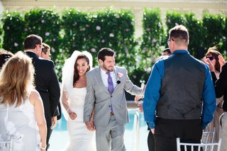 bride-in-a-strapless-vera-wang-dress-veil-and-groom-in-grey-suit-purple-tie-rose-boutonniere