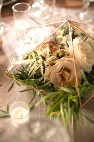 wedding-reception-candle-votive-next-to-rose-gold-copper-terrarium-with-rose-flowers-greenery