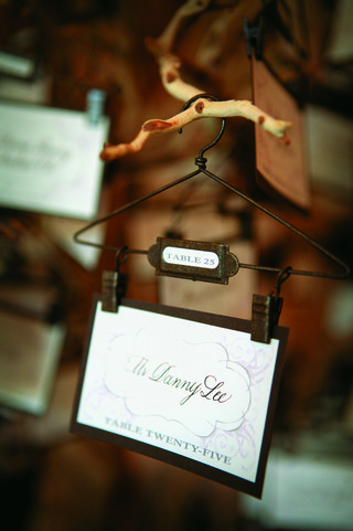 escort-card-on-mini-hanger-hanging-from-tree