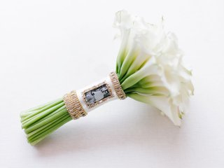 cheryl-burke-wedding-bouquet-white-calla-lily-exposed-stemss-wrapped-with-crystal-and-photo-of-dad