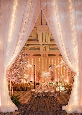 twinke-lights-within-drapery-at-wedding-reception