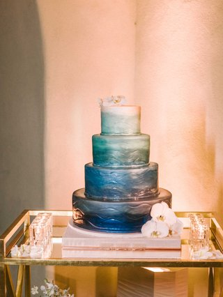 four-layer-wedding-cake-painted-with-dark-blue-fading-to-light-sea-foam-green-and-white-fondant
