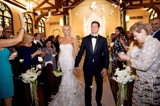 bride-in-marchesa-wedding-dress-and-groom-in-tuxedo-church-recessional