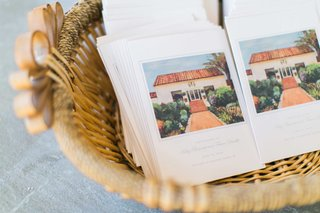 basket-filled-with-wedding-ceremony-programs-with-drawing-of-the-inn-at-rancho-santa-fe-on-front