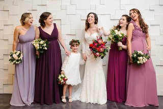 bridesmaids-with-bride-wearing-mismatched-gowns