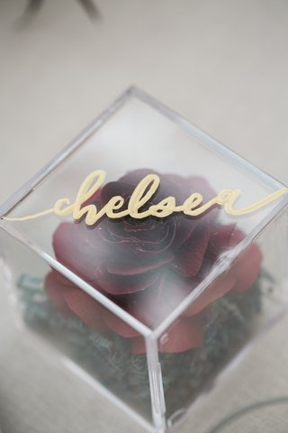 place-card-and-bridal-shower-favor-with-paper-rose-inside-of-acrylic-box-with-gold-calligraphy
