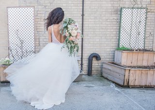 back-of-bride-in-pantora-bridal-wedding-dress-backless-bridal-gown-with-tulle-skirt