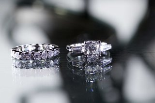 engagement-ring-four-prong-with-baguette-side-stones-three-stone-ring-and-diamond-eternity-band