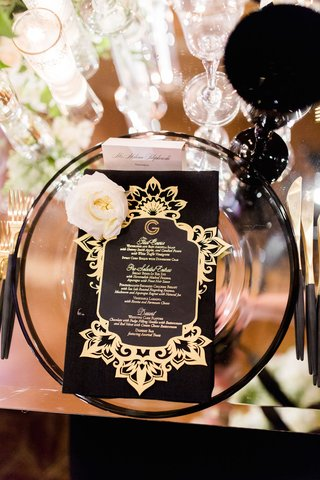mirror-table-black-goblet-glassware-gold-menu-card-monogram-fresh-flower-black-gold-flatware-candles