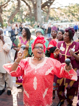 woman-with-maracas-during-performance-at-wedding-ceremony-southern-gospel-choir-outside-of-chapel