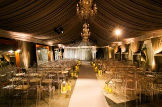 dimly-lit-ceremony-space-with-gold-and-white-details-in-the-decor