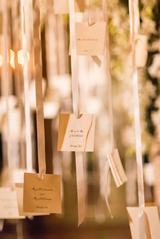 small-white-escort-cards-hanging-from-white-ribbons