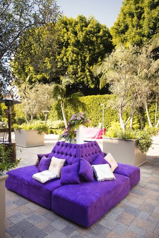 outdoor-wedding-cocktail-hour-vibiana-purple-settee-bench-lounge-furniture-silver-pillows