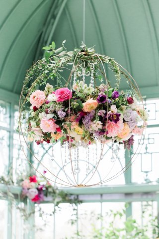 floral-chandelier-shaped-like-a-sphere-with-cascading-crystal-accents