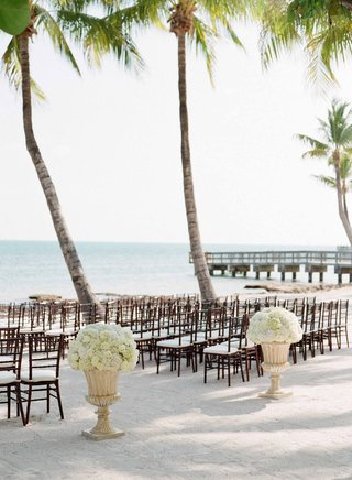 ivory-hydrangea-and-white-rose-in-tan-urn-on-sand-at-beach-wedding-ceremony-in-key-west-florida