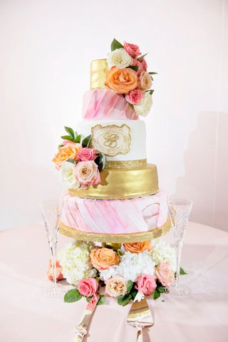 wedding-cake-with-gold-layer-monogram-pink-draped-watercolor-design-fresh-flowers