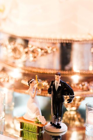 tiny-statues-of-a-bride-cheerleader-and-groom-hockey-player