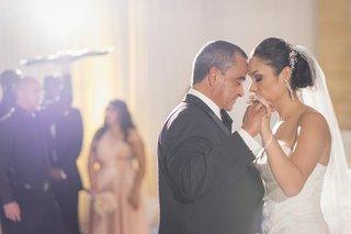 bride-in-a-strapless-mark-zunino-dress-dances-with-father-in-a-black-tuxedo