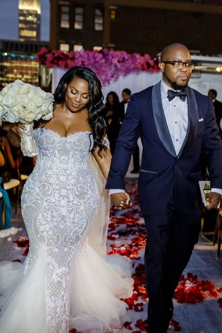 bride-mermaid-wedding-dress-white-bouquet-with-groom-holding-hands-african-american-night-ceremony