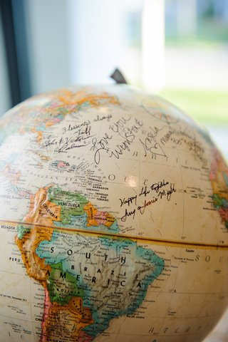 ivory-and-colorful-globe-map-with-notes-from-guests