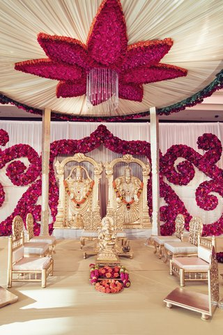 south-indian-wedding-ceremony-altar-with-fuchsia-blossoms-arranged-in-scroll-on-ceiling