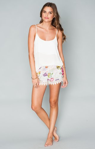 white-slip-top-and-floral-patterned-shorts-with-lace-edges