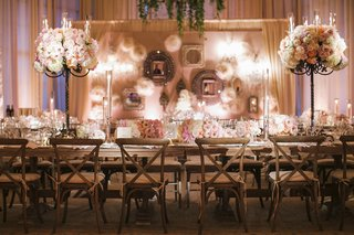 wooden-tables-with-peach-and-white-flowers-and-draping