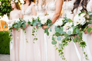 bridesmaids-in-ivory-and-blush-dresses-with-pretty-garden-flowers-ivy-and-jasmine-greenery-neutral