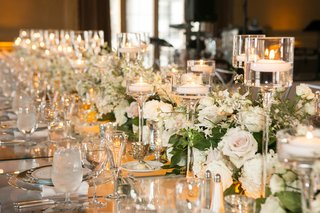 runner-of-flowers-and-floating-candles-in-glass-pedestals