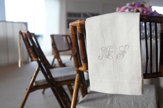 white-table-cover-featuring-silver-initials-embroidered-onto-cloth